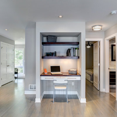 Study room - small transitional built-in desk medium tone wood floor study room idea in Minneapolis with gray walls