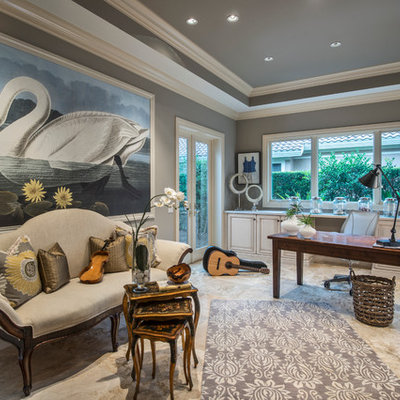 Mid-sized tuscan freestanding desk beige floor and porcelain tile home office photo in Miami with gray walls and no fireplace