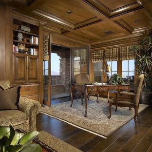 Example of a tuscan freestanding desk dark wood floor home office design in Phoenix