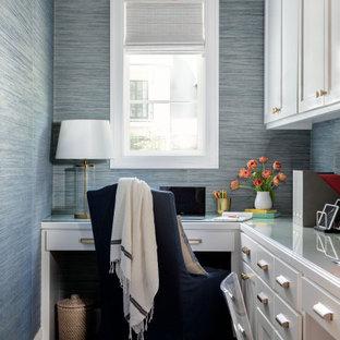 На фото: огромный кабинет в стиле современная классика с местом для рукоделия, синими стенами, кирпичным полом, встроенным рабочим столом и обоями на стенах с