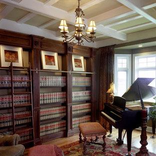 Large elegant medium tone wood floor study room photo in Milwaukee