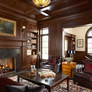 Home office - traditional dark wood floor home office idea in Minneapolis with white walls, a standard fireplace and a stone fireplace