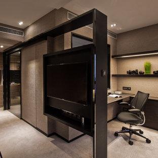 Imagen de despacho contemporáneo con escritorio empotrado