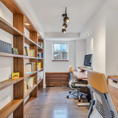 Inspiration for a mid-sized contemporary freestanding desk dark wood floor and brown floor study room remodel in New York with no fireplace and white walls