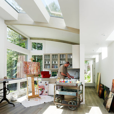 Inspiration for a contemporary freestanding desk medium tone wood floor home studio remodel in San Francisco with white walls