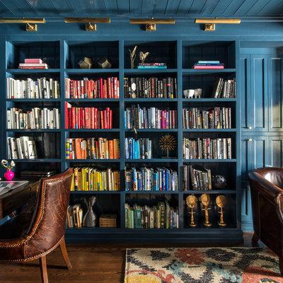 Elegant freestanding desk dark wood floor home office library photo in San Francisco with blue walls