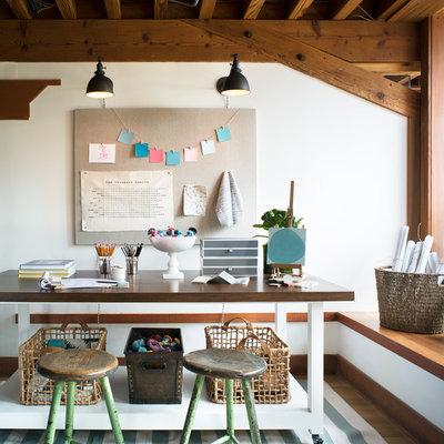 Home studio - contemporary freestanding desk medium tone wood floor home studio idea in San Francisco with white walls