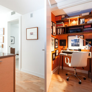 Home office - small contemporary freestanding desk light wood floor home office idea in San Francisco with orange walls