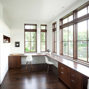 Inspiration for a contemporary built-in desk home office remodel in Minneapolis with white walls