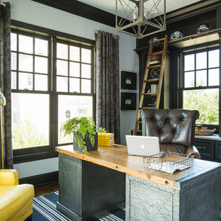 Inspiration for a transitional freestanding desk dark wood floor home office remodel in Minneapolis with gray walls