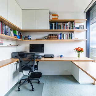 Photo of a mid-sized contemporary study room in Melbourne with white walls, carpet and a built-in desk.