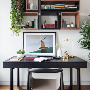 Small modern study in London with a freestanding desk.
