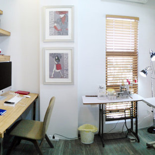Craft room - mid-sized zen built-in desk porcelain floor craft room idea in Other with white walls