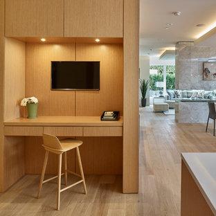 Идея дизайна: маленький кабинет в стиле модернизм с белыми стенами, светлым паркетным полом, двусторонним камином, фасадом камина из плитки, встроенным рабочим столом и бежевым полом