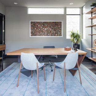 Esempio di un ufficio design di medie dimensioni con pareti bianche, pavimento in gres porcellanato, scrivania autoportante e nessun camino