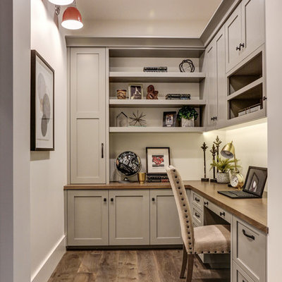 Inspiration for a transitional built-in desk medium tone wood floor and brown floor study room remodel in Phoenix with white walls and no fireplace