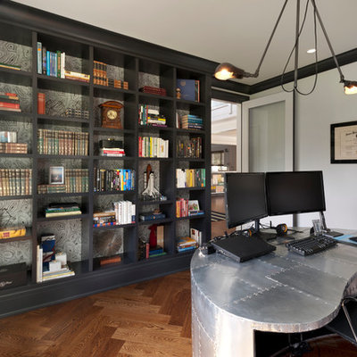 Study room - mid-sized industrial freestanding desk medium tone wood floor study room idea in New York with white walls and no fireplace