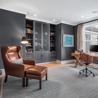 Mid-sized transitional freestanding desk medium tone wood floor and brown floor study room photo in New York with gray walls and no fireplace