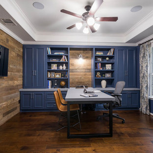 Study room - beach style built-in desk dark wood floor and brown floor study room idea in Houston with blue walls and no fireplace