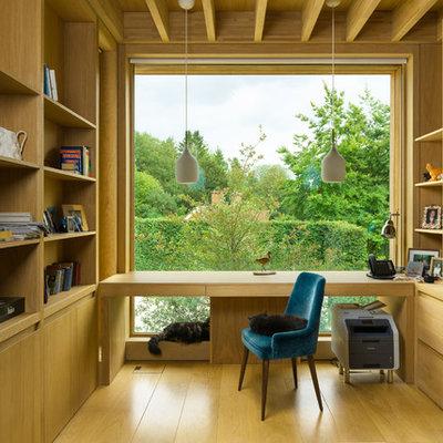 Study room - mid-sized modern freestanding desk light wood floor and beige floor study room idea in Oxfordshire