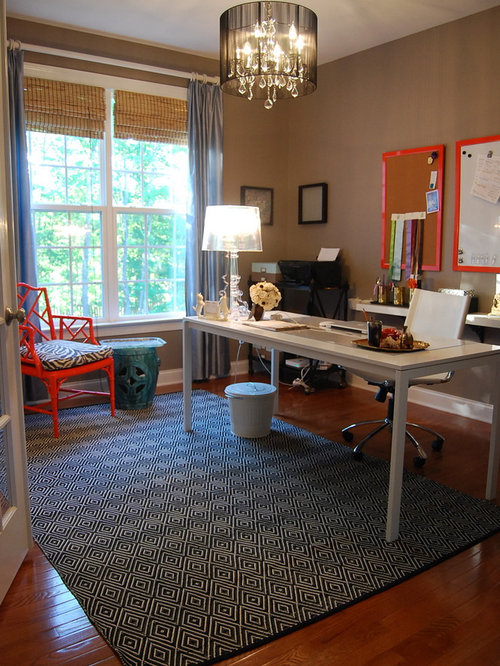 Example Of A Trendy Dark Wood Floor Home Office Design In Raleigh With Brown Walls And
