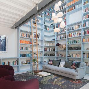 Modern inredning av ett mellanstort arbetsrum, med vita väggar och grått golv