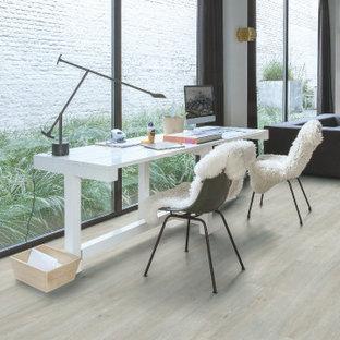 Idée de décoration pour un bureau minimaliste avec un sol en vinyl et un sol gris.