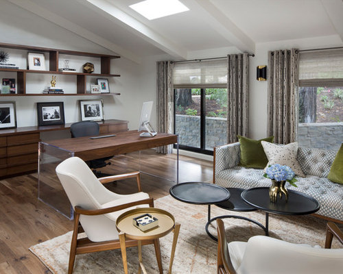 1960s freestanding desk medium tone wood floor study room photo in los angeles with white walls - Mid Century Modern Home Office