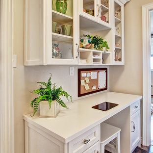 Example of a small classic built-in desk linoleum floor home office design in Toronto with beige walls