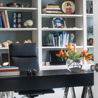 Transitional freestanding desk dark wood floor study room photo in Chicago with gray walls