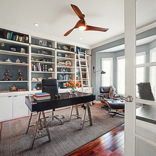 Example of a transitional freestanding desk dark wood floor study room design in Chicago with gray walls