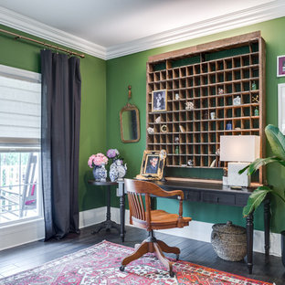 Example of a mid-sized eclectic freestanding desk dark wood floor and black floor study room design in Other with green walls