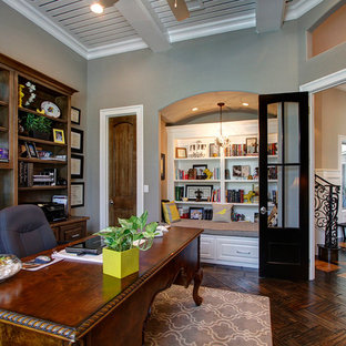Home office - traditional freestanding desk dark wood floor home office idea in Dallas with gray walls