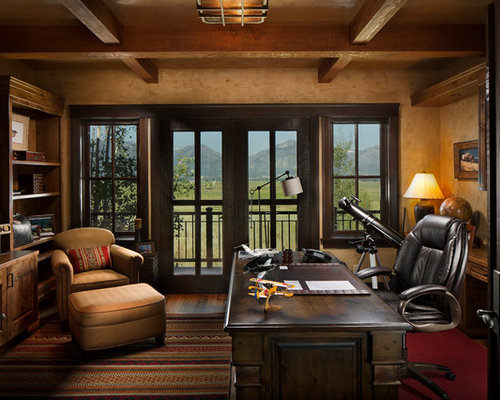 example of a large mountain style freestanding desk dark wood floor and brown floor study room