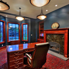 Mediterranean Home Office by Maggetti Construction Inc.