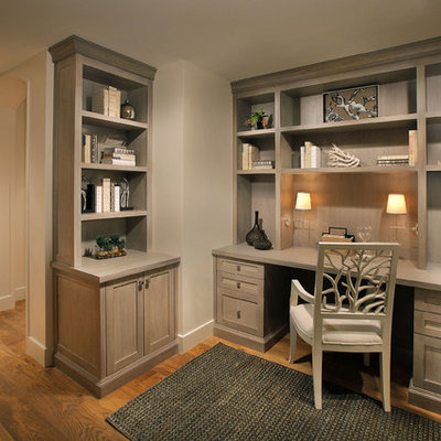 Study room - mid-sized traditional built-in desk medium tone wood floor and brown floor study room idea in Miami with beige walls and no fireplace