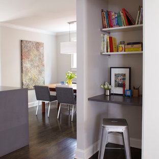 Example of a small trendy built-in desk dark wood floor study room design in Atlanta with gray walls and no fireplace