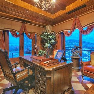 ソルトレイクシティの巨大なトラディショナルスタイルのおしゃれな書斎 (大理石の床、コーナー設置型暖炉、石材の暖炉まわり、自立型机) の写真