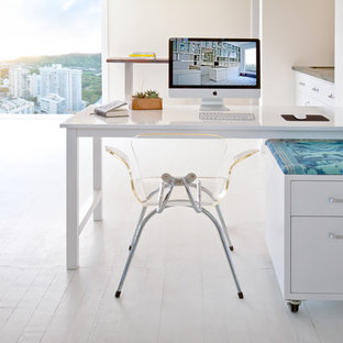 Home office - contemporary freestanding desk painted wood floor home office idea in Orange County with white walls