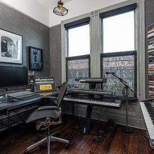 Trendy freestanding desk brown floor and dark wood floor home studio photo in San Francisco with gray walls