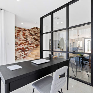 Photo of a mid-sized scandinavian study room in Perth with white walls, a freestanding desk and grey floor.