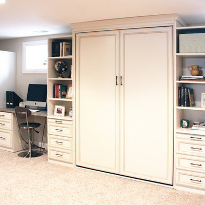 Example of a large classic built-in desk carpeted and beige floor home office design in Phoenix with beige walls and no fireplace