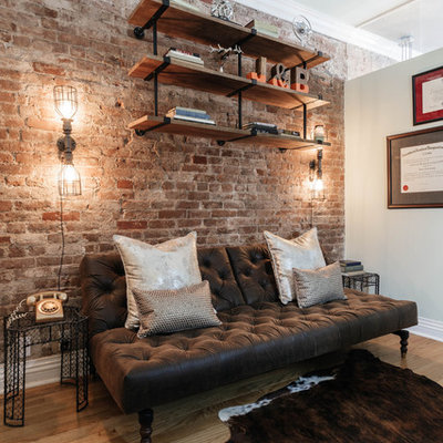 Small urban freestanding desk medium tone wood floor and brown floor study room photo in New York with beige walls and no fireplace