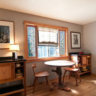 Example of an ornate medium tone wood floor home office design in Portland with gray walls