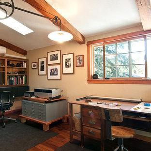 Home office - traditional freestanding desk dark wood floor home office idea in Portland with beige walls