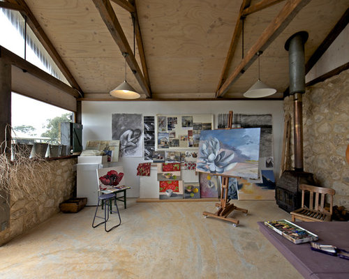 Inspiration For A Rustic Home Studio Remodel In Adelaide With White Walls  And A Wood Stove