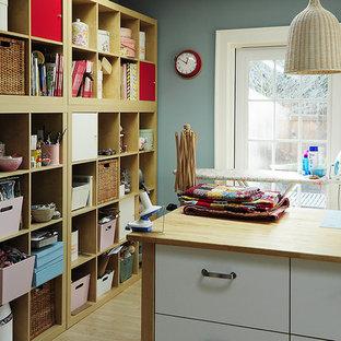Craft room - contemporary light wood floor craft room idea in Portland with blue walls
