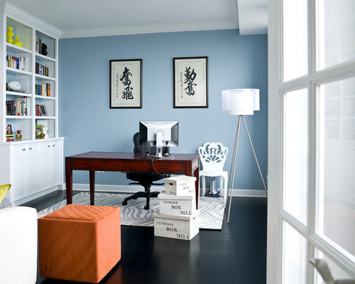 example of a transitional home office design in chicago with blue walls and a freestanding desk