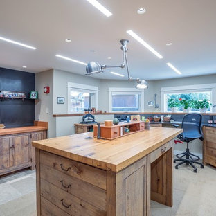 Mid-sized mountain style freestanding desk gray floor craft room photo in Denver with gray walls