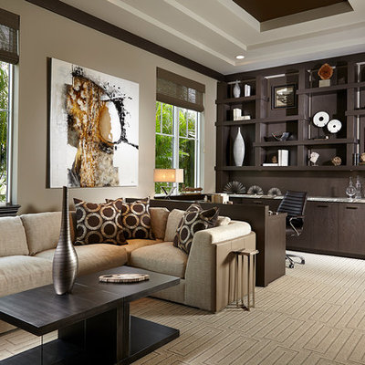 Example of a large transitional built-in desk carpeted and beige floor study room design in Miami with beige walls